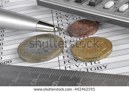 Financial background with money, calculator, table, ruler and pen.