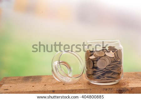 Financial background with money coins in clear bottle. World trade financing concept. - stock photo