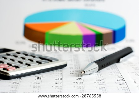Financial balance and stock market reports. - stock photo