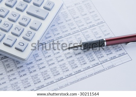 financial balance sheet with calculator and pen - stock photo