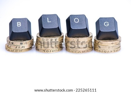 Financial blog header word  on coins piles isolated - stock photo