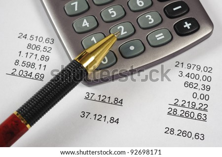 financial budget calculation with calculator over account - stock photo