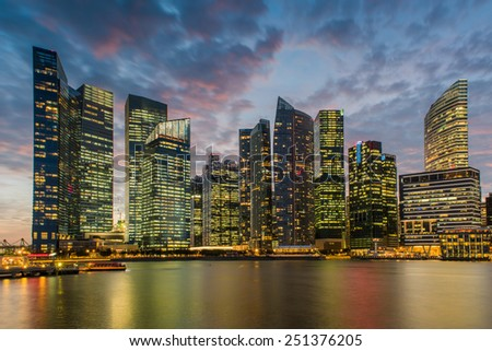 Financial Building in Marina Bay, Singapore with twilight sky - stock photo