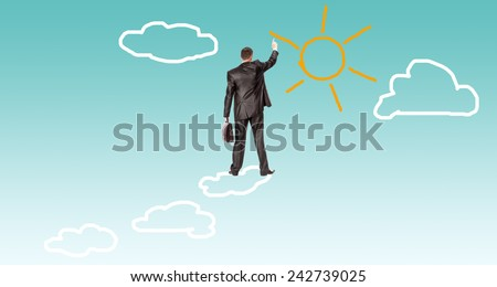 Financial business.Businessman over clouds - stock photo