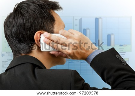 Financial businessman on phone reporting - stock photo