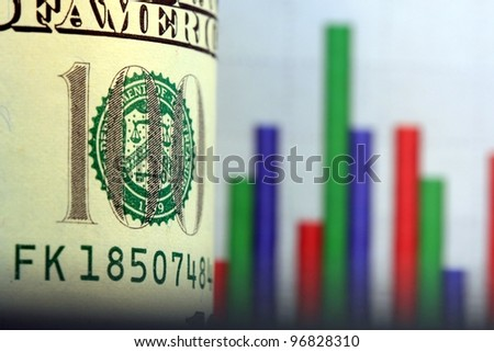 Financial Chart and US Currency One Hundred Dollar Bills. - stock photo