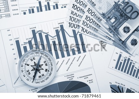 financial charts and graphs on the table - stock photo