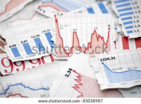 Financial charts from newspapers - stock photo