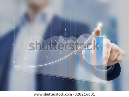 Financial charts showing growing revenue on touch screen - stock photo