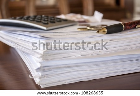 financial composition on the table with money, calculator and pen - stock photo