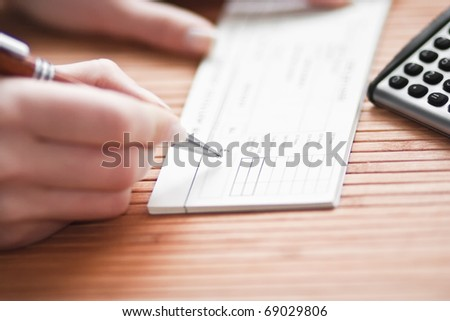Financial concept - filling paycheck - stock photo
