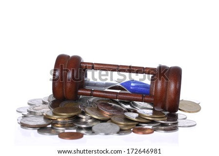 Financial concept, Hourglass with coins - stock photo