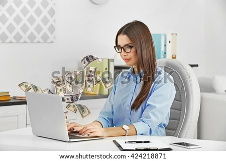 Financial concept. Make money on the Internet. Beautiful young woman working at the modern office - stock photo