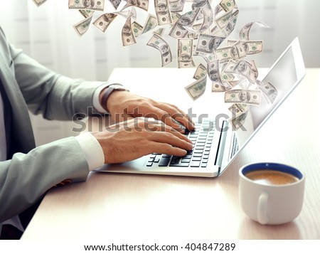 Financial concept. Make money on the Internet. Man working with laptop in office - stock photo