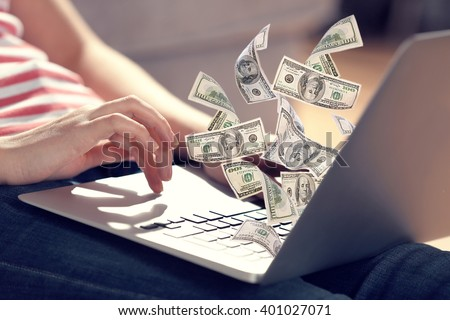 Financial concept. Make money on the Internet. Woman sitting on the floor and working with a laptop - stock photo