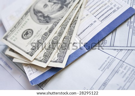 Financial concept - money, pen and financial documentation - stock photo