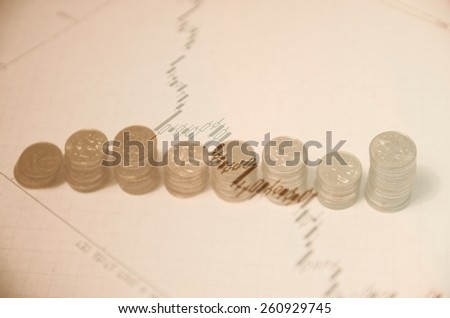 Financial concept on PC screen. Financial data & coins. - stock photo