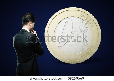Financial concept with thinking businessman looking at zero euro coin on dark blue background - stock photo