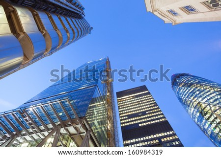 Financial Corporate building Skyscrapers in the Canary Wharf at night , City of London  - stock photo
