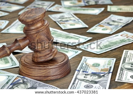 Financial Crime or Fraud or Auction Concept Image With Judges Gavel or Auction Hammer And Money Stack On The Background, Close Up - stock photo