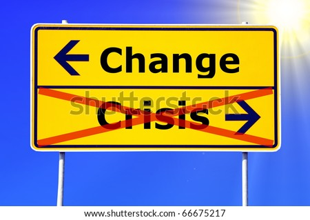 financial crisis and change concept with road sign - stock photo
