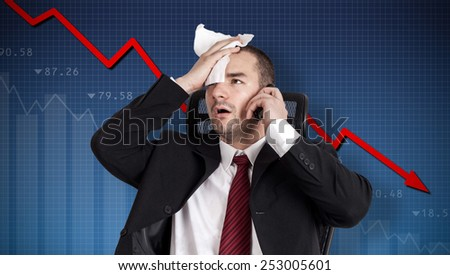 Financial crisis. Broker holding forehead - stock photo