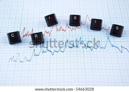 Financial crisis chart in two colors and word with letters of computer keyboard - stock photo