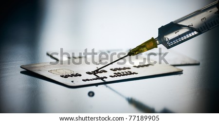 Financial crisis concept: Injecting funds to credit card - stock photo