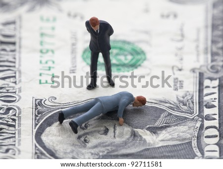 Financial crisis. Figure of businessman on one dollar bill - stock photo