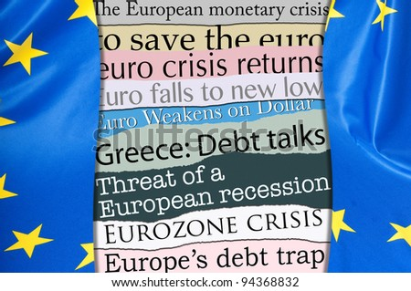 Financial Crisis in Europe - Newsletters Headlines about Financial Crisis With Flag of European Union - stock photo