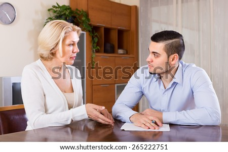 Financial crisis in family of depressed adult son and his senior mature mother
