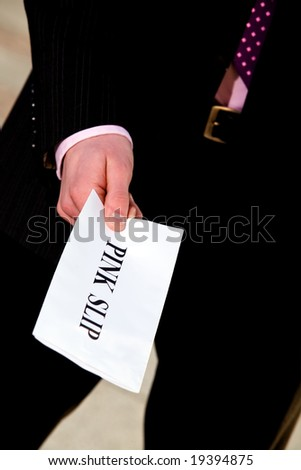 Financial crisis. Manager giving a job termination notice Pink Slip - stock photo