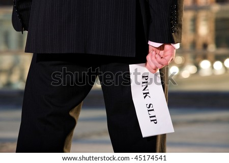 Financial crisis. Manager holding a job termination notice Pink Slip