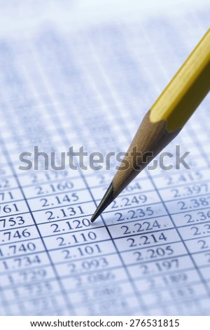 Financial data analyzing , shot with very shallow depth of field, blue tone - stock photo