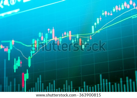 Financial data on a monitor. Business statistics and analytics, glowing sheet beznes statistics of exchange trading in the dark