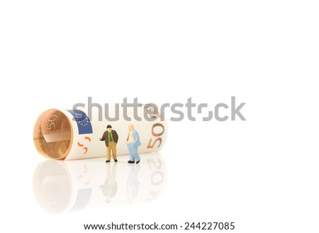 Financial deal concept,Roll of money Euro paper bills and businessman isolated on white with clipping path - stock photo