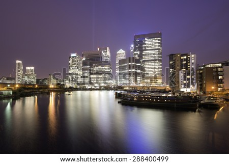 Financial district of Canary Wharf at night, London - stock photo