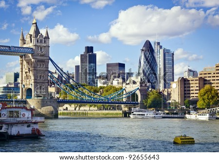 Financial District of London and the Tower Bridge - stock photo
