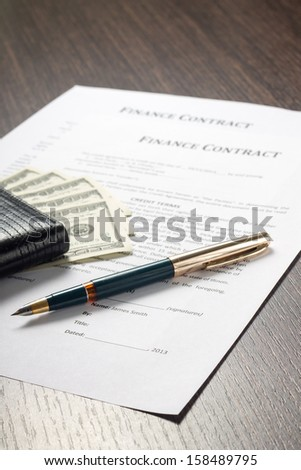 Financial document with wallet, money and fountain pen - stock photo