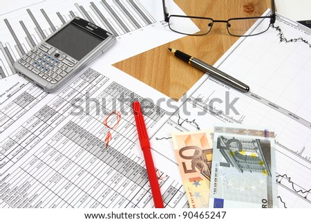 Financial documents - business related objects. Glasses, fountain pen and Euro currency money. - stock photo