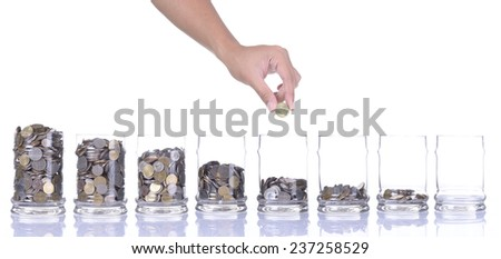 Financial education concept with hands putting coins isolated on white background - stock photo