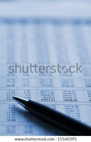 Financial figures making decision. Duo tone blue tone. - stock photo
