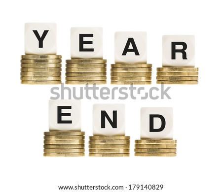 Financial Fiscal Tax Year End on Gold Coins - stock photo
