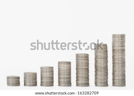 Financial graph of coins isolated on white background.