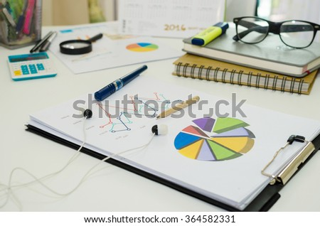 Financial graphs analysis on table. - stock photo