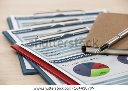 Financial graphs and charts on table