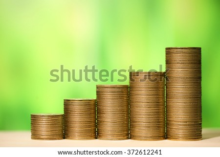 Financial growth concept money. Graph from coins - stock photo