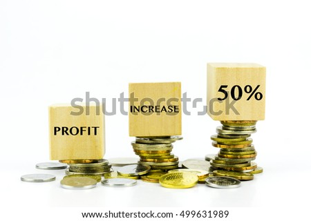 Financial increase concept - Stack of coins and 50% written