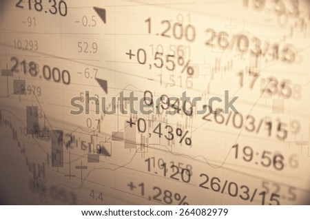 Financial information on PC monitor. - stock photo