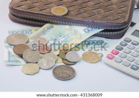 Financial investments across different currencies.Wallet insert currency of the country in both Asia and Europe. - stock photo